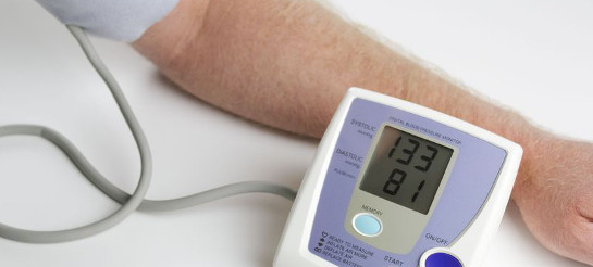 man measuring his blood pressure
